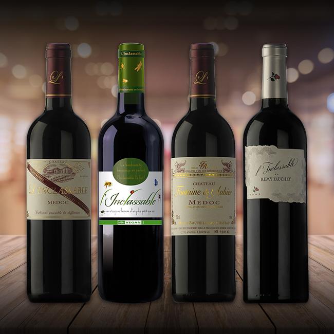quatre bouteilles vin l'inclassable posées sur planche bois